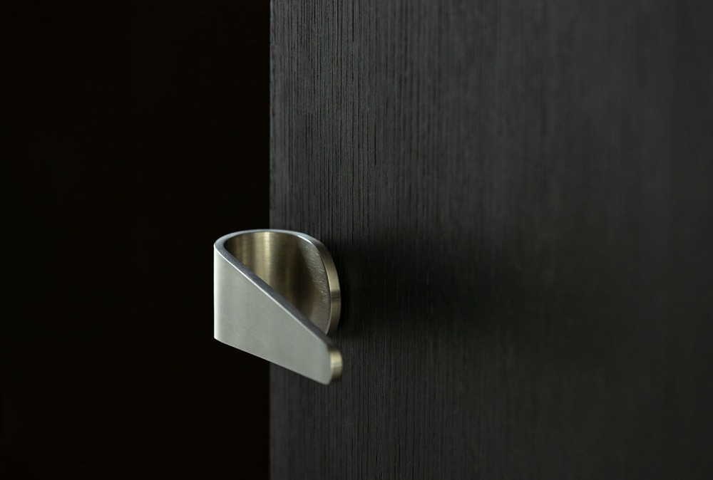 Satin stainless steel door handle by Tord Boontje