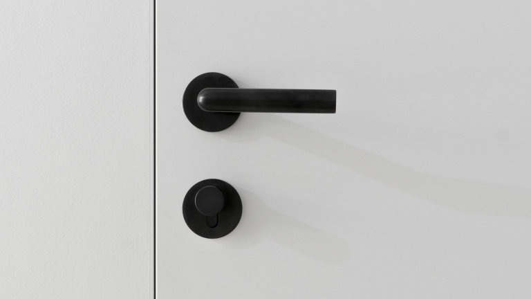 Solid sprung lever handle on rose - INC collection