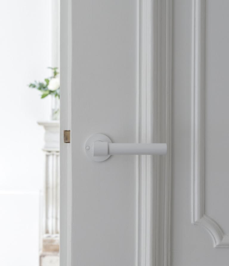 white door handle on rose
