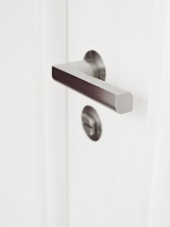 Satin stainless steel lever handle on rose