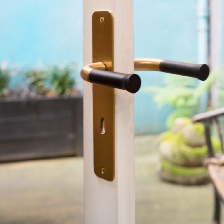 gold door handle on shield